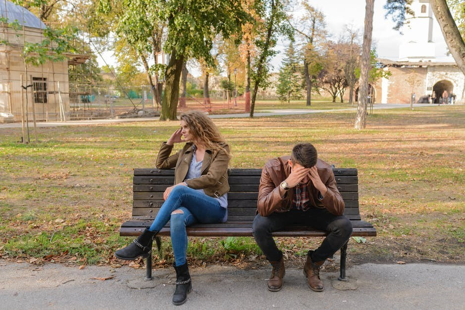 man-and-woman-arguing-on-park-bench