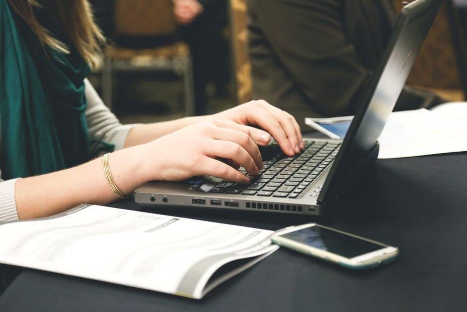 woman-writing-on-computer